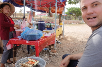 We stopped for the most fabulous meal. This lady had this little barbecue, and it seemed her main customers were the other vendors in the tiny market behind us, though a couple schoolkids came up too, and a mom on a scooter with all her kids. This lady seemed to be quite the community figure, everyone knew her. We sat with her, eating mysterious balls of food-like substances, for about an hour.