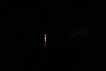 Another boat approaches in the dark