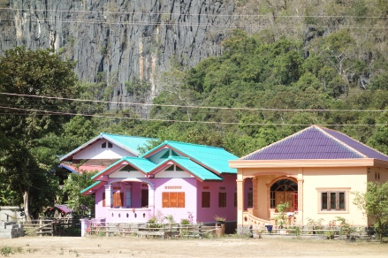 There are lots of incredibly pretty pink and green and blue and purple and peach houses. Here are two.