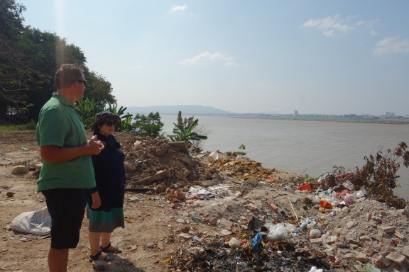 Luke and Jocelyn take in a *lovely* view of the Mekong from Savannakhet, a town that we stopped in for the night en route to other stuff.
