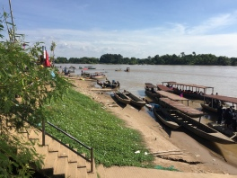 Catching the boat to Don Khon. We left our poor car on shore for four days.