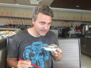 Luke poses with a crab at the buffet