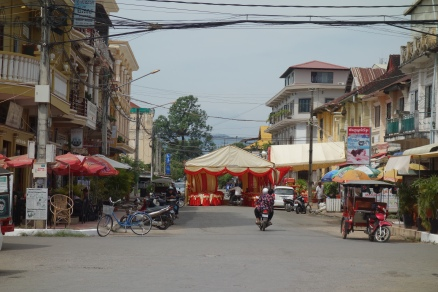This is how they do weddings in Cambodia. They erect tents on the side, or in the middle, of a busy street. They then blare music all day long, long before the guests arrive.