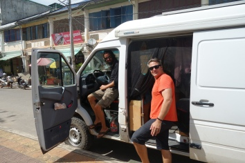 Getting into the big white van in Kampot.