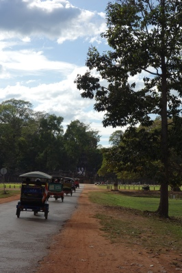 An army of tuktuks goes towards Terrace of the Elephants. Tuktuks are the main mode of transportation around the enormous Angkor complex.