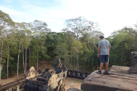 Luke looks over the edge on Ta Keo