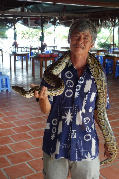 He actually seemed really disappointed that we didn't want to hold it. He seemed like he thought we were dumb white people who were afraid of a silly 8 foot Python for no reason whatsoever.