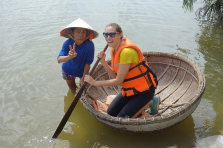 And this lady showed us how to row a bamboo boat. She was a performer, and hilarious - before we were introduced to her, she was creeping silently around the group, tickling the backs of people's necks with a reed.