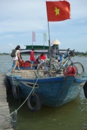 Finishing our bike tour with a boat ride back to Hoi An