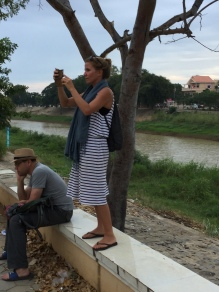 Jenny taking pictures of an instense hacky-sacker by the river in Battambang.